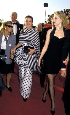 If anyone can rock stripes and polka dots to the Academy Awards, it's Audrey. via StyleList