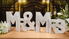 Silver painted paper mache letters