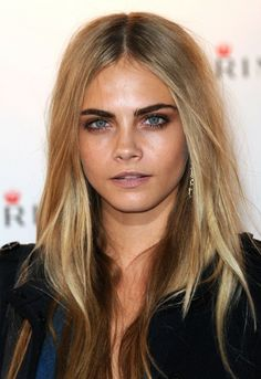 Miss Delevingne Looking Bronzy On The Red Carpet, With A Loaded Eyeliner Around Her Blue Eyes, And Her Blonde Locks Straightened. Cara Is Simply Stunning.