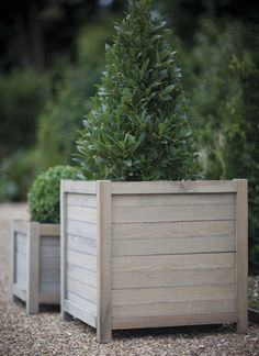 Handcrafted from contemporary slatted panels of Spruce, our large wooden planter is ideal for the patio, decking or walkway.