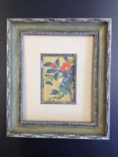 Framing design by Nick at HHFAS for a small handcrafted fabric image of a bird using Larson-Juhl mouldings.
