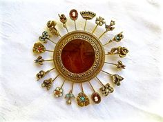 This listing is for a huge vintage Goldette stickpin brooch unsigned with intaglio cameo center depicting Eros and Cupid . The stick pins are decorated with seed pearls, rh... #vintagevoguetreasure