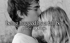 Being hugged by a tall boy