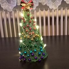 My first dyi Christmas tree. 49 baubles for the victims of Pulse