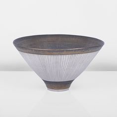 LUCIE RIE, Conical Bowl, circa 1980, Porcelain, the interior with bright golden bronze glaze with radiating sgraffito lines, the exterior with inlaid raidiating lines between golden bronze bands around the rim and foot, impressed LR seal