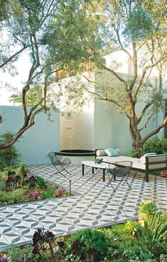 beautiful tile that offers a moroccan feel to the succulent surroundings