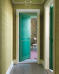 I am absolutely in love with this door. A cheap hollow door looks expensive with paint and upholstery tacks
