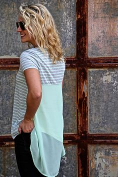 Rayon/polyester blended. Mint/grey in color. Sheer back. Model is a 2/3 in this photo and is wearing a small. Small 2-4/5, Medium 6-8, Large 10-12