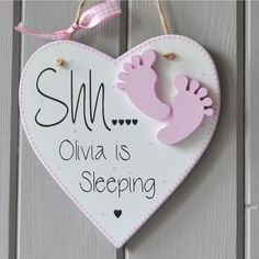 Shh... Baby Sleeping Plaque , hand painted in white and pink with decorative dotted detailing. Each plaque is personalised to create a unique gift for a new baby. The heart shaped plaque is 150mm x 150mm by 6mm thick (6 inches x 6 inches x 0.25 inches thick) and made from high