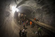 Sandhogs work in a tunnel in the East Side Access project, more than 15 stories beneath Midtown Manhattan where workers are building a new terminal for the Long Island Railroad, the United States' busiest commuter rail system, is seen during a media tour of the site in New York, November 4, 2015. Two enormous caverns, each several city blocks long, will house eight tracks and platforms, serving an estimated 162,000 customers a day.