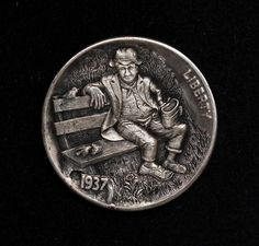 Hobo Nickel by Alex Ostrogradsky.  Carved on a 1937 Buffalo nickel.  Micro carving with toes protruding from the shoe and amazing bird details too.