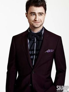 Photographed by Matthew Lyn for Sharp's November cover story, Kill Your Darlings star Daniel Radcliffe dons sharp sartorial styles. Whether in a bow-tie and cardigan or turtleneck and coat, Radcliffe charms in a wardrobe styled by Randy Smith (Judy Inc).