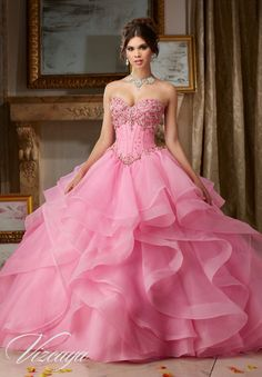 Morilee Vizcaya Quinceanera Dress 89107 JEWELED BEADING ON FLOUNCED ORGANZA BALL GOWN Matching Bolero Jacket. Available in Champagne, Iced Pink, White (Color of this dress): Iced Pink