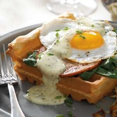Eggs Florentine with Savory Waffles and Herbed Hollandaise -- trade in the English muffin for a waffle to swoozie up eggs benedict.