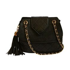 1989 CHANEL black raffia and quilted leather bag with gilt chain & tassel | From a collection of rare vintage handbags and purses at https://www.1stdibs.com/fashion/accessories/handbags-purses/