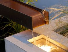Fountain design, I love the juxtaposition of solid rectilinear shapes and flowing water