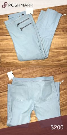 NWT Monika Chiang Blue Leather Moto Pants These are new with tags. Baby blue Monika Chiang leather moto pants with metallic silver-tone piping throughout, three welt zip pockets at front, zip accent at cuffs and hidden zip closure at center front. Fabric: 100% Leather Designer: Monika Chiang Monika Chiang Pants