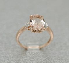 14k Rose Gold Diamond And Oval Morganite Ring by SparkleNJade - jewelry findings, jewellery collection, jewellery online websites *sponsored https://www.pinterest.com/jewelry_yes/ https://www.pinterest.com/explore/jewelry/ https://www.pinterest.com/jewelry_yes/wholesale-jewelry/ https://www.helzberg.com/category/jewelry.do