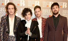 LONDON, ENGLAND - FEBRUARY 22: EDITORIAL USE ONLY. George Daniel, Matt Healy, Adam Hann and Ross MacDonald of The 1975 attend The BRIT Awards 2017 at The O2 Arena on February 22, 2017 in London, England. (Photo by David M. Benett/Dave Benett/Getty Images )