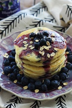 These are the BEST blueberry pancakes! Moist, fluffy, and packed with yummy oats! Skip the bowl of oatmeal and fix these blueberry OATMEAL pancakes instead!