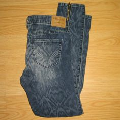 """Hollister Skinny Jeans w/ Ankle Zippers These jeans are preloved but still in very good condition. They are a skinny (possibly jegging) style patterned jeans with back ankle zippers. The fading in the front and back is factory intended. Made of 99% cotton 1% elastane. Tag size is W27/5. Inseam is approximately 26"""" long. Hollister Jeans Skinny"""