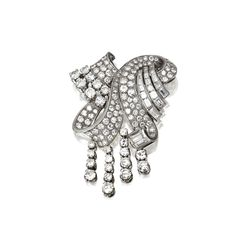 DIAMOND CLIP-BROOCH, CIRCA 1950 The fanciful ribbon scroll supporting four flexible fringes, set with 116 round and single-cut diamonds and 23 baguettes weighing a total of approximately 14.00 carats, mounted in platinum.