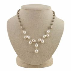 The statement necklace that doesn't scream. Also available in all white.