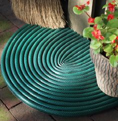 Garden hose to door mat #DIY #upcycle #repurpose featured at totallygreencrafts.com