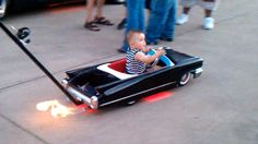 Flame-spitting, low-riding baby buggy.