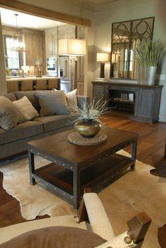 Rustic living room, cow hide rug..love everything about this room!