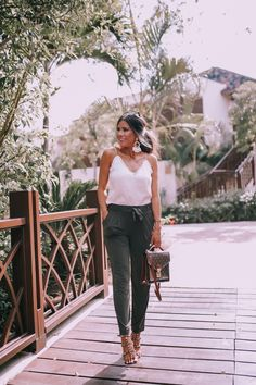 JUNE 20, 2018 A Comfy, Yet Chic Outfit To Wear To Work or Vacay - OUTFIT DETAILS: CAMI: Express c/o   OLIVE JOGGERS: Express c/o   HEELS: Valentino   SUNGLASSES: Le Spec   HANDBAG: Louis Vuitton   EARRINGS: BaubleBar   RING: Express c/o   BRACELET: Express c/o