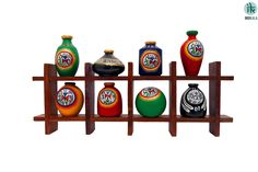Set of Eight multi coloured handpainted warli pots artistically placed on a sheeshem wooden frame to add colour and life to your wall and house. A classy yet ethnic piece of art.