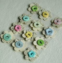 flowers punched from book pages with button centres - love it