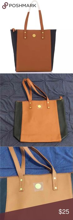 """Leather Tote/Shopper Brand new!!! no tag Tote/shopper Color: Navy and camel Joy Mangano Details: Approx. 11-1/2""""L x 5""""W x 14-5/8""""H with a 9"""" strap drop Shell:100% Saffiano leather Lining:Leather, RFID fabric pocket Country of Origin:Imported  FEATURES Classic shopper profile with fashionable colorblock design Great for daily use at the office, gym, shopping and more Full zip top closure for easy access Self-repairing zippers with leather tabs Roomy interior for easy viewing Soft exterior…"""
