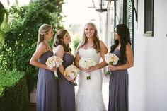 The bride and her ladies - bouquets are white and blush with pops of orange