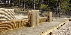 the footbridge deck as matrix elements of benches, loungers, the parking and garbage bins are fully integrated into a plank deck