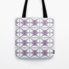 """Purple and blue geometric print tote bag  Our quality crafted Tote Bags are hand sewn in America using durable, yet lightweight, poly poplin fabric. All seams and stress points are double stitched for durability. Available in 13"""" x 13"""", 16"""" x 16"""" and 18"""" x 18"""" variations, the tote bags are washable, feature original artwork on both sides and a sturdy 1"""" wide cotton webbing strap for comfortably carrying over your shoulder."""