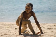 Playing in the sand,  Wimbe beach, Pemba, Mozambique