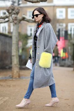 Narciss grey and coloured fur detail coat, Peter Pilotto printed top, Asos jeans, Aldo nude studded shoes, Karen Walker sunglasses Sophie Beresiner - Beauty Director What ELLE Wears, Fashion Week Street Style.