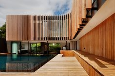 Kooyong Residence by Mat Gibson Architecture has recycled Blackbutt timber fins.