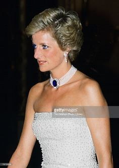 Princess Diana wearing a white strapless dress, embroidered with pearls, designed by Catherine Walker for a banquet during her official visit to Hungary, A pearl and sapphire choker completes the look  (Photo by Tim Graham/Getty Images)