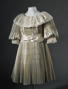 An incredible pleated little girl's dress from circa 1895.
