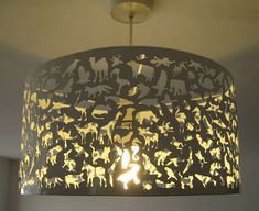 Beasties silhouette cutout hanging lamp. Really interesting.