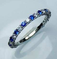 GIA G. G Certified Platinum .68 tcw Natural Blue Sapphire & Diamond  Band - GIA G. G Appraisal value $2,195.70.for sale wholesale $1,650.00.