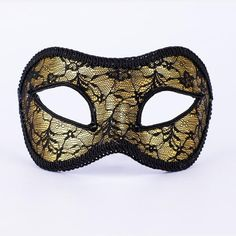 Golden Lace.Striking yet delicate, this beautiful lace mask is crafted in a simple Colombina style using thoughtful materials and fabrics. vivomasks.com Lace Masquerade Masks, Lace Mask, Black Trim, Halloween Face Makeup, Fabrics, Delicate, Crystals, Simple, Unique