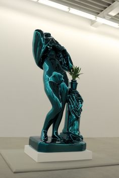 "Jeff Koons, ""Metallic Venus,"" 2010-2012, seen at Galerie Almine Rech, Brussels.[content:shareblock]""The original source is a small Hungarian porcelain from the turn of the 19th century. This piece makes reference to the sculptor Praxiteles, the first to undress Aphrodite. He is known for putting the head in this kind of a three quarter position, making the body limber and using this kind of architectural support in the narrative of the sculpture. Here, the support becomes a cloth with a a…"