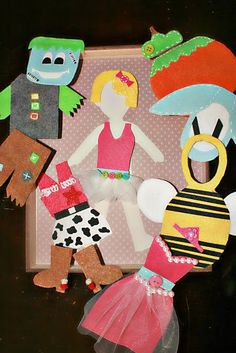 """felt """"paper doll"""" with costumes to dress up in"""