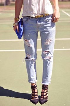 like the old worn out jeans look, but polished with fancy heels and a clutch. cute