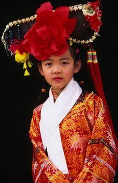 Portrait of girl dressed in traditional Manchurian costume. | © Keren Su