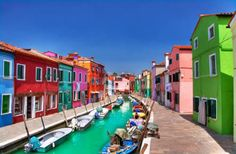 Eye-Popping by /Suzy-Strutner The Huffington Post If you're in need of an emotional boost, take a virtual trip to the chipper town of Burano, Italy on this fine Travel Tuesday. The wee island is located in the same lagoon as Venice, but its colors pop and fizzle in a way that makes it feel almost tropical.